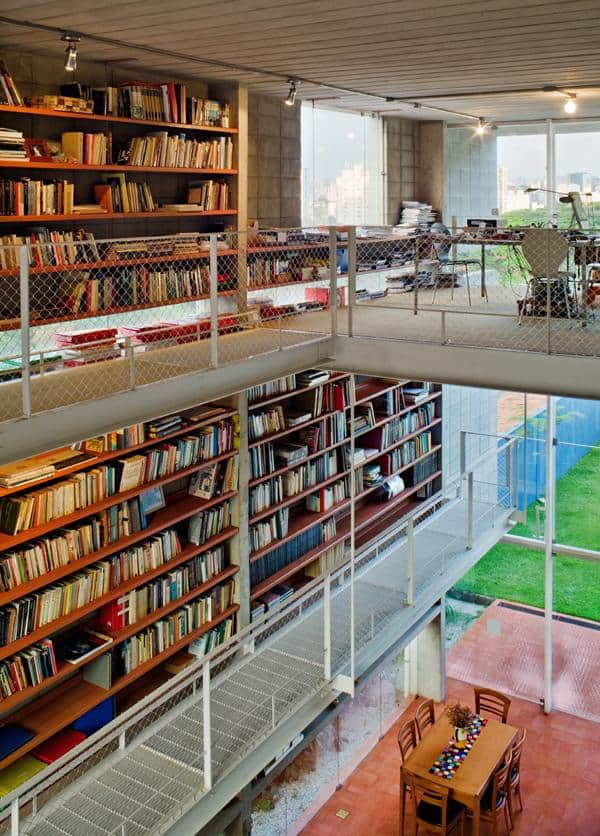 3 storey wall books creates privacy contemporary home  1 library