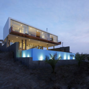 Rectangular Beach House with Floating Glazed Upper Floor