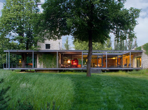Modern Glass Home in Krakow, Poland comes with a tree and a tower!